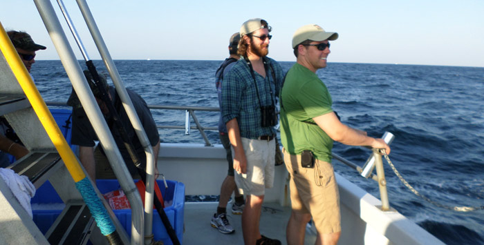 Andy and Alex watching as we caught a Wahoo on the way out to the gulf stream on the first day. We later ate it for dinner!