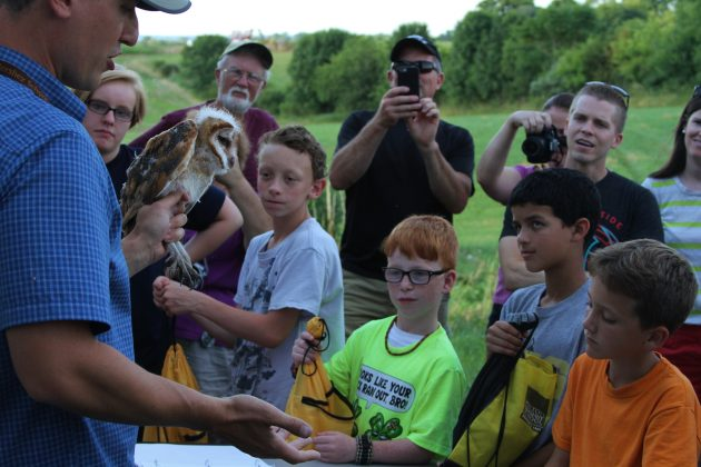 Nate showing off a Barn Owl to the crowd (Photo by Alex Lamoreaux)